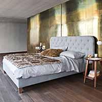 Blue Wall Design - Polsterbett-Design. Luxusbetten.